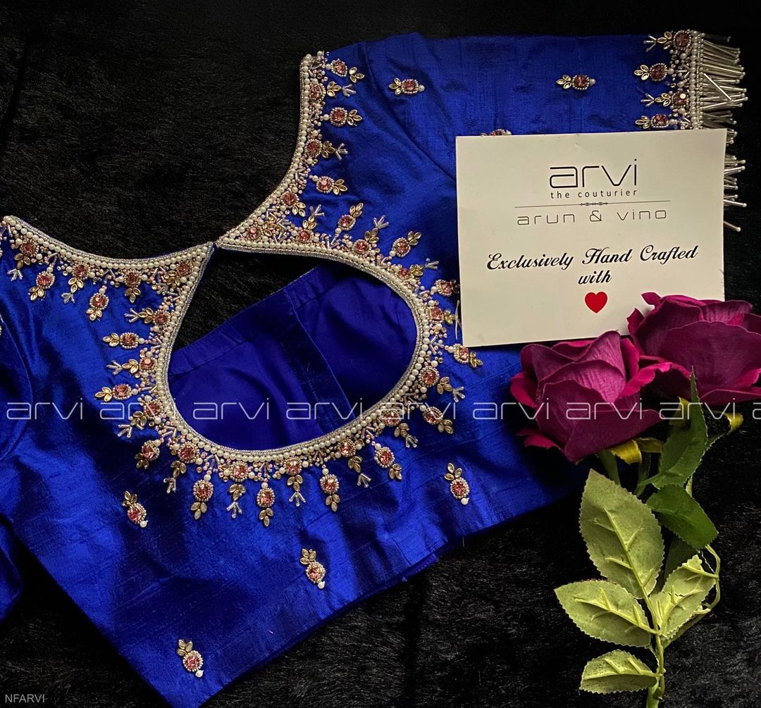 Gorgeous royal blue color designer blouse with silver thread and bead aari work. 2021-04-03