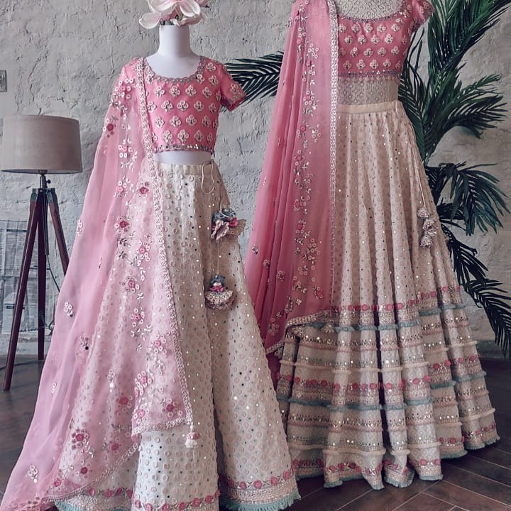 How cute is this mom and daughter set! Stunning blush pink color lehenga and blouse with net dupatta. Mom and daughter Lehenga set with classy hand embroidery work.  2021-04-03