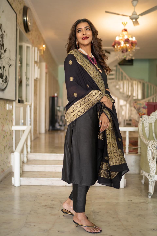 Nothing says classic like  . Beautiful Lakshmi Manchu Black Suit  . Black Suit: Raga Kunche. Dupatta: Rajyalakshmi Heritage Banaras Sarees. Neckpiece: Tiraa by Tibarumal Jewels. Makeup: Manasa Makeup Artist Photography : Nehal Kaza Styled By Image Craft by Shweta Malpani. 2021-04-04