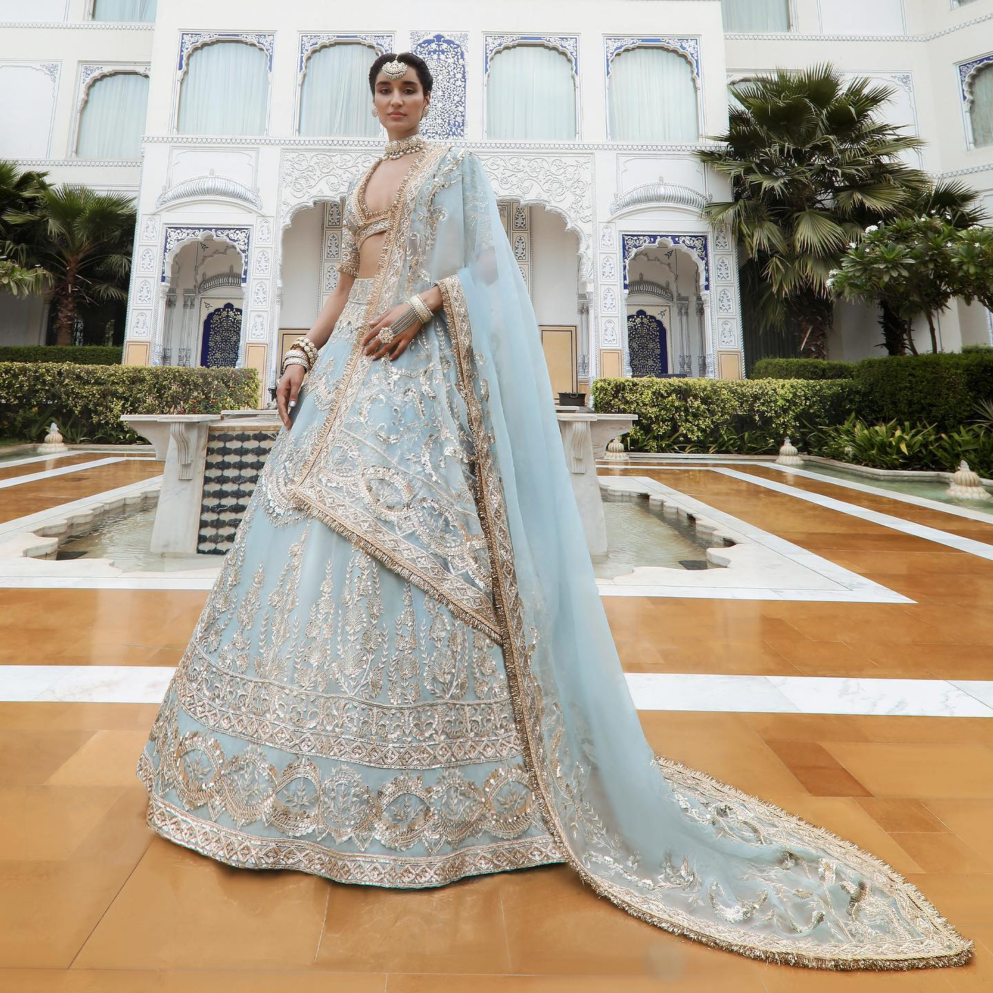 Under the dense cloud of embroideries like badla zari and sheaths of sequins glowing in its grandiosity this timeless elegance moulds into an aquatic contemporary classic with an expansion of signature #Noor bodice adding a distinct feminity to the look! 2021-04-04