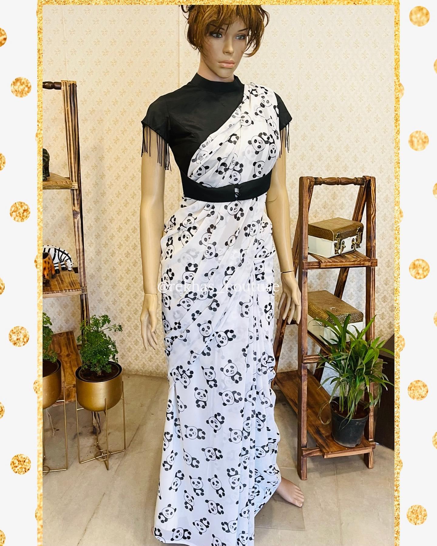 Gorgeous pearl white color designer and black high neck waist belt blouse. Saree with panda print. Panda hug  whatsapp  or  7893545554. 2021-04-04