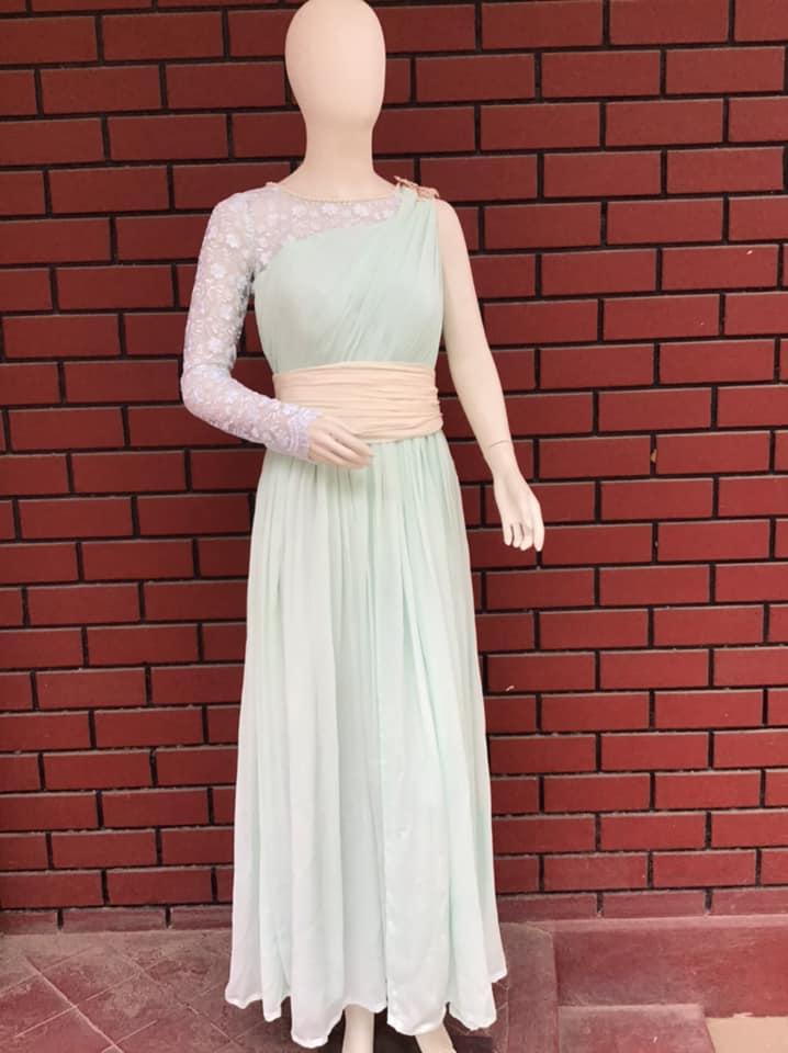 one shoulder Aqua blue gown Lavishly draped with Pearl embellishments embroidered lace fabric and belt with a bow in the back can be your absolute go to for any kind of occasion. Be it birthday parties or cocktail nights you can pull this off elegantly.  . . . Designed by Lavender The Boutique For details-  Contact : +91- 9886765047. 2021-04-04