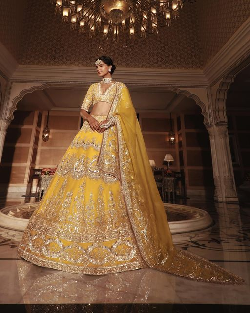 Rejoice a timeless nooraniyat in a delightful canary yellow hue organza lehenga designed with all-over floral motif embroidery accompanied by our tonal Noor bodice and sheer scalloped drape! 2021-04-04