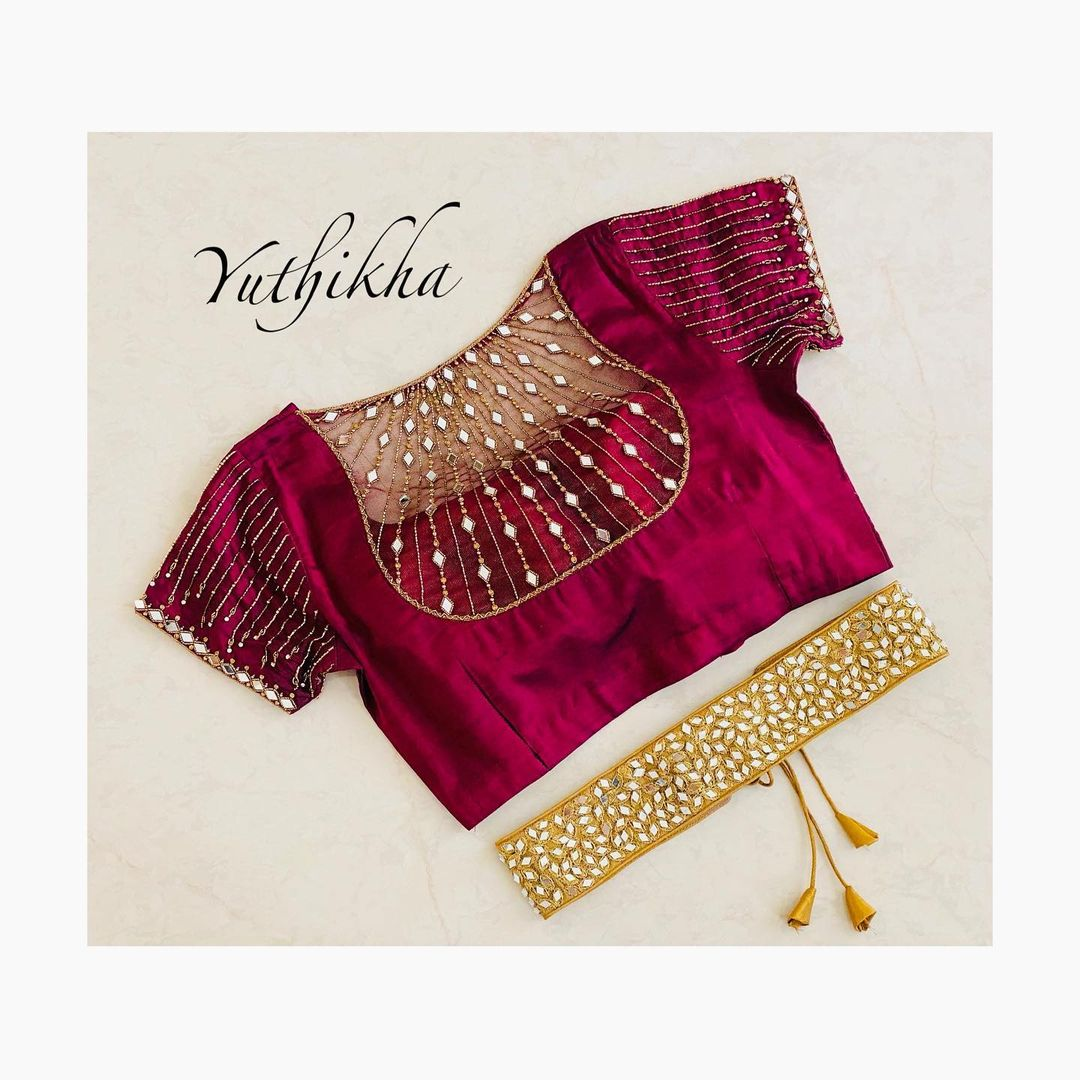 Bespoke mirror work net embroidery blouse and waist belt from the house of Yuthikha designer studio!!! For appointments contact 9894231384. 2021-04-04