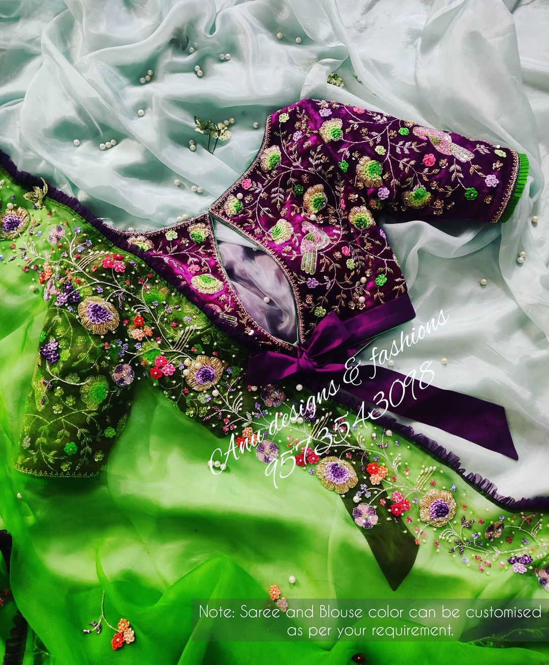 Stunning parrot green color designer saree and purple blouse. Saree and blouse with floral design hand embroidery 3D maggam work. Saree and blouse cost is Rs.35200/-