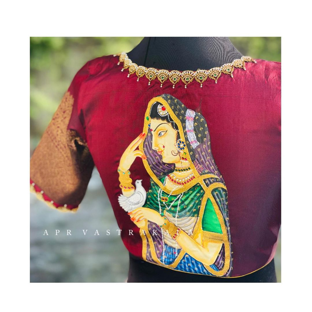 Stunning marron color designer blouse with Tanjore painting hand embroidery maggam work.  2021-04-04