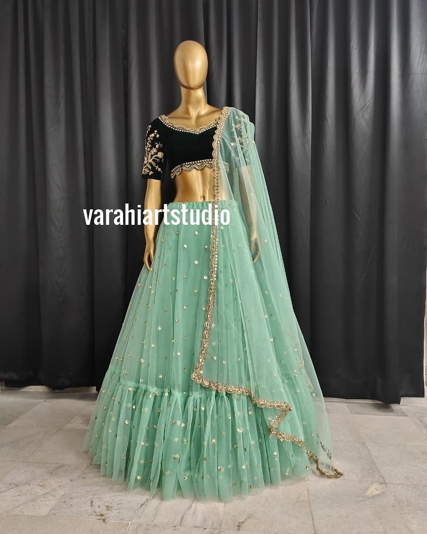 Handicrafted Bridal Lehenghas Available from Varahi art studio .. Gorgeous olive green net lehenga and black velvet blouse with net dupatta.