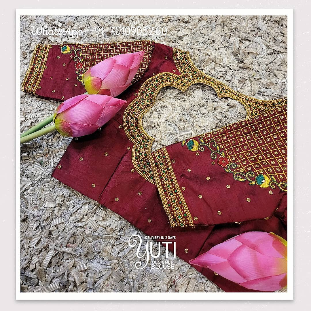 Beautiful maroon color designer blouse with cut work and bead aari work. 2021-04-04