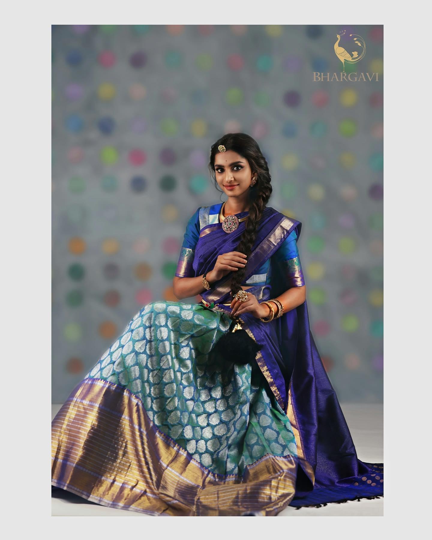 Traditional pattu halfsaree. Stunning powder blue color kanchi pattu lehenga and blouse with deep nevy blue dupatta.  2021-04-05