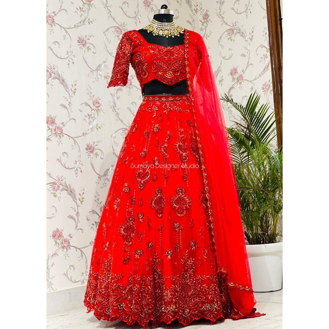 Stunning red color Hand crafted designer bridal lehengas from Sumaya!