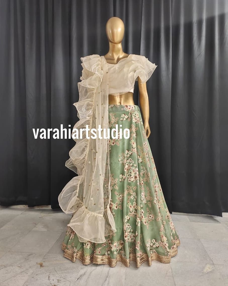 Stunning olive green color floral lehenga and pearl white ruffle blouse with ruffle dupatta.