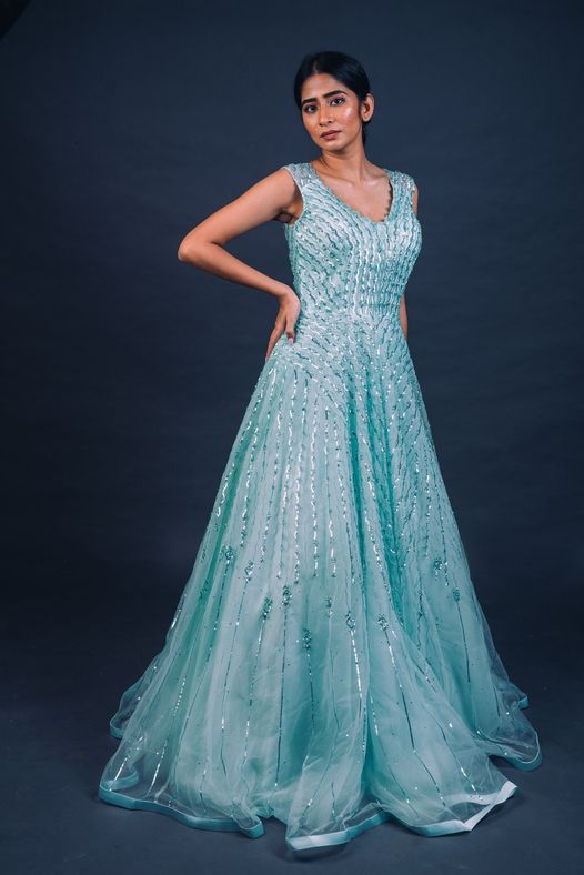 Swoon under the Spell of Beauty! Frosty shaded Blue Gown bedazzled with metallic appliques and beadwork in a style befitting of a Snow Queen. Get this Exclusive Modern Classic Frozen Treatment for yourself.