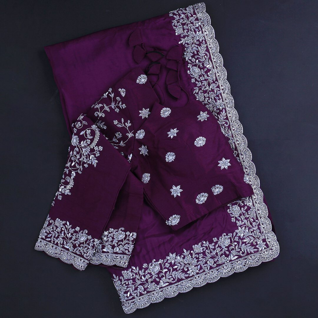 Embrace the timeless affair of fine silhouettes! This gorgeous crepe saree in mesmerising purple is adorned with silver handcrafted zardosi across the border! A fully embellished blouse in raw silk certainly adds to the glamorous look!  Worldwide free shipping Contact : 00919845922959 Email: Esales@samyakk.com Product Code: RJ2575 2021-04-06