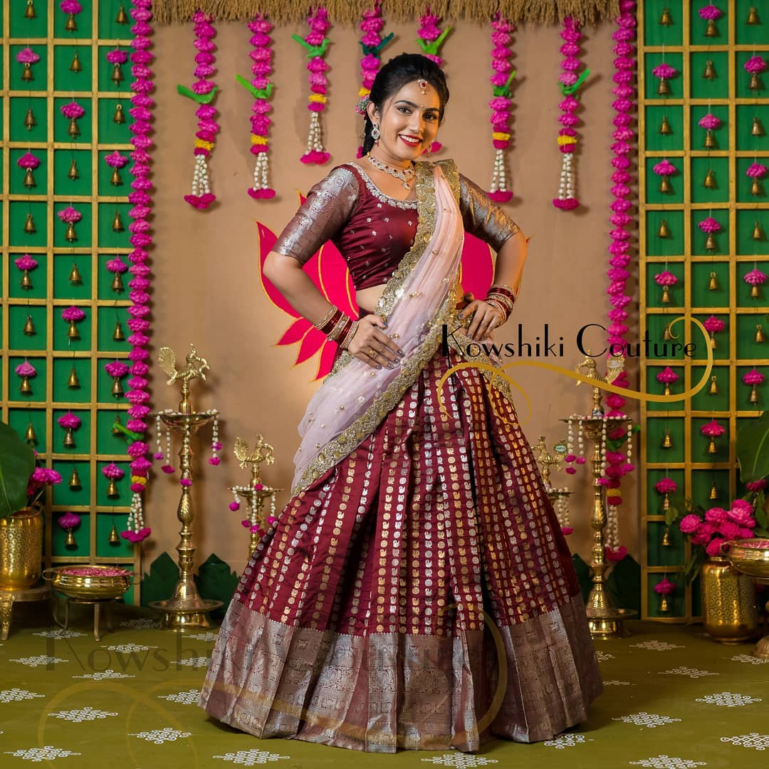 Stunning marron pattu lehenga and blouse with blush pink color net dupatta. Blouse with hand embroidery.  2021-04-06
