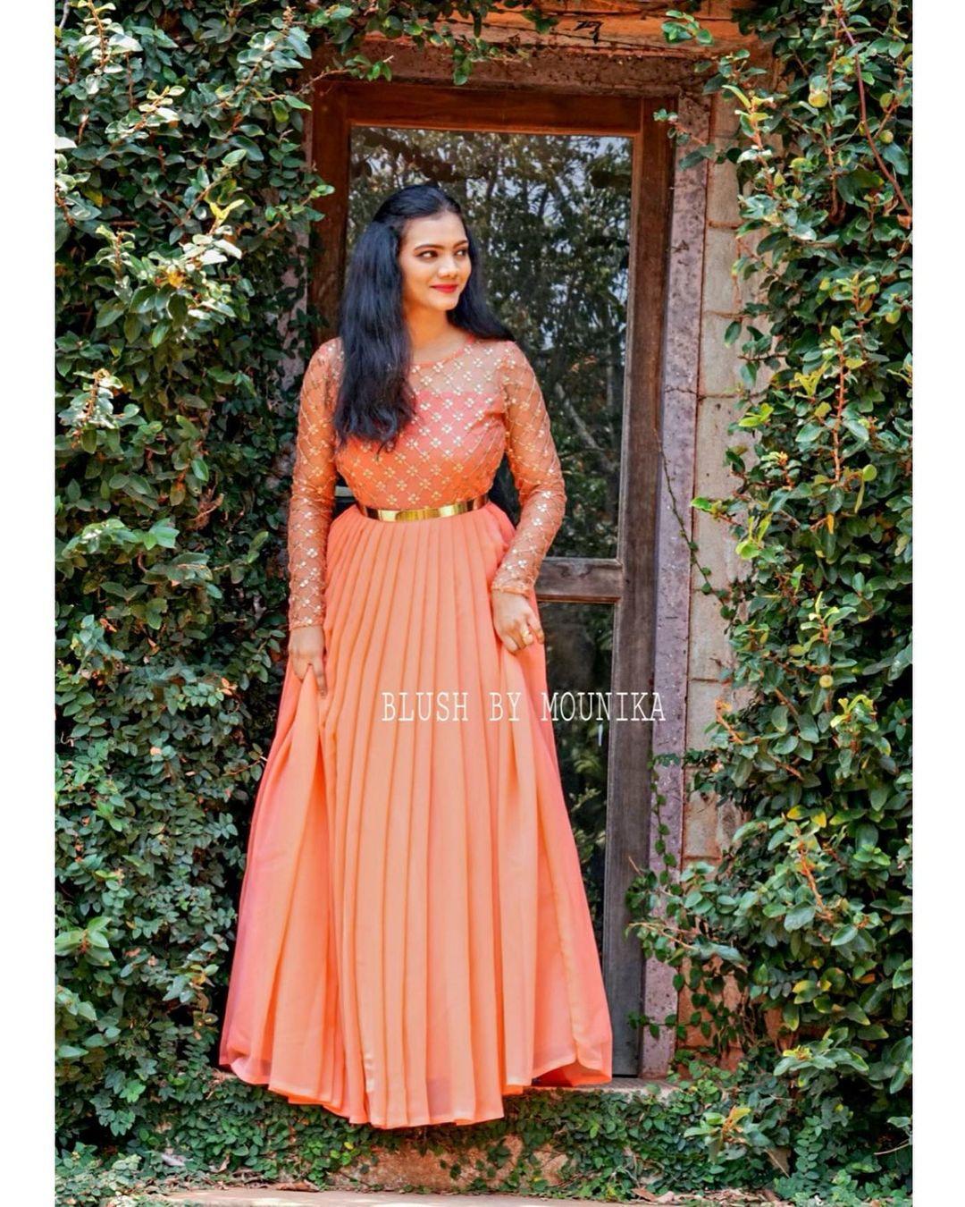 Tropical peach pleated floor length dress with waist belt. 2021-04-06