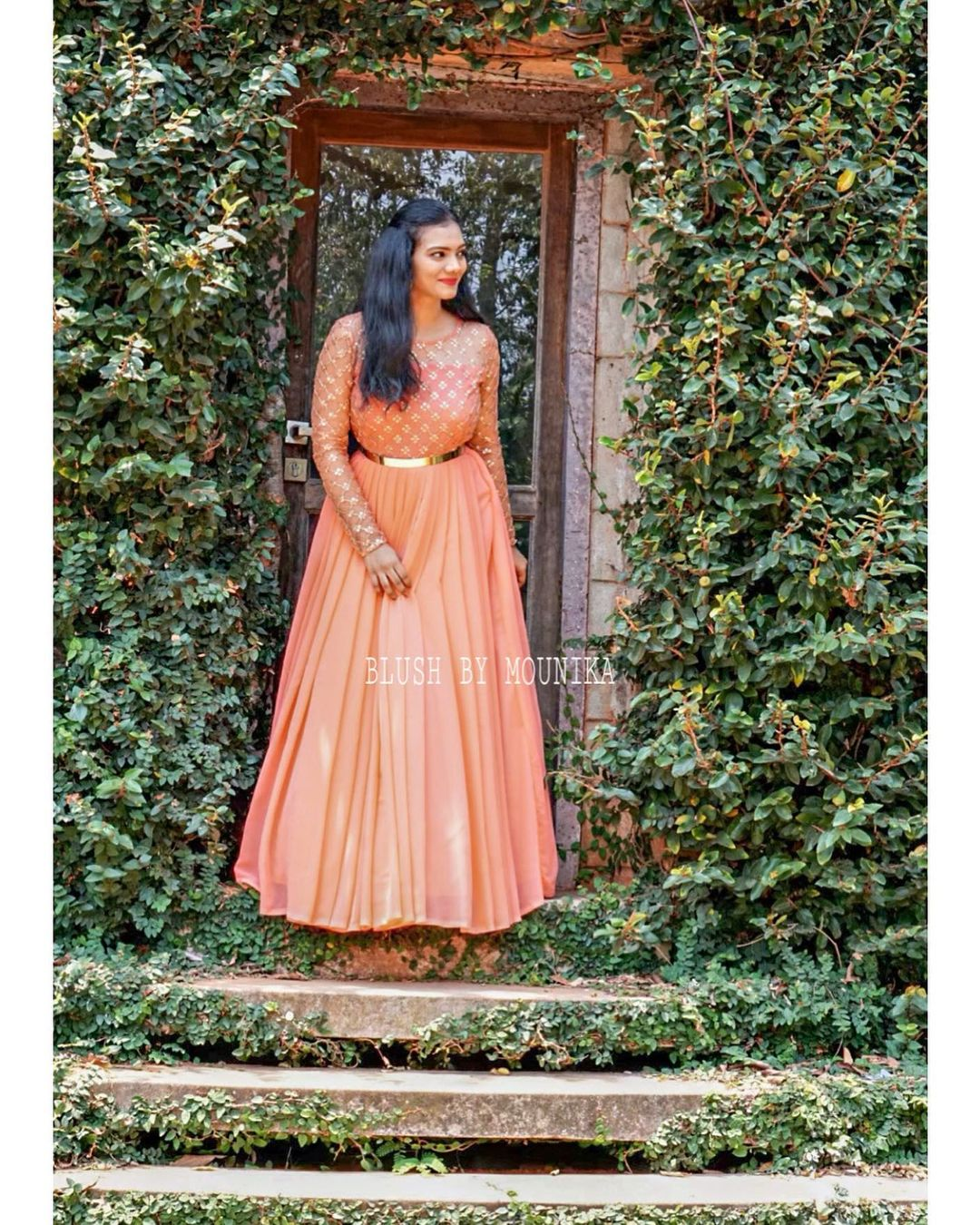 Tropical peach pleated floor length dress with waist belt. 2021-04-06