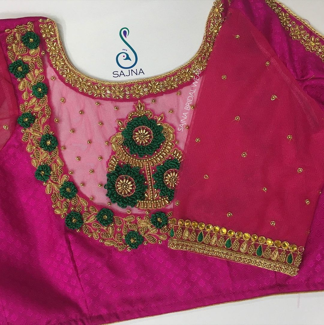 Gorgeous rani pink color designer sheer blouse with floral design hand embroidery thread and kundan aari work.  2021-04-06