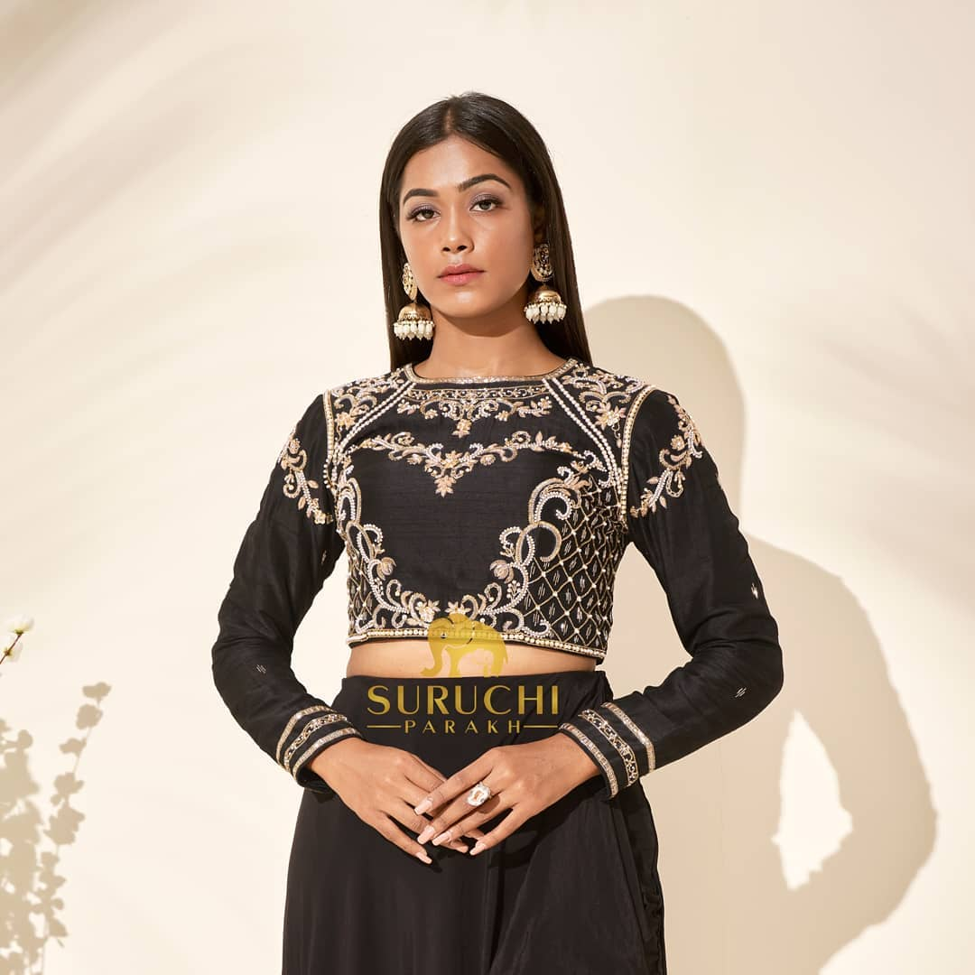 Give a transition to your fashion by giving your ethnic outfit a western spin with this hand embroidered crop top paired with a drape skirt and embroidered pants! 2021-04-07