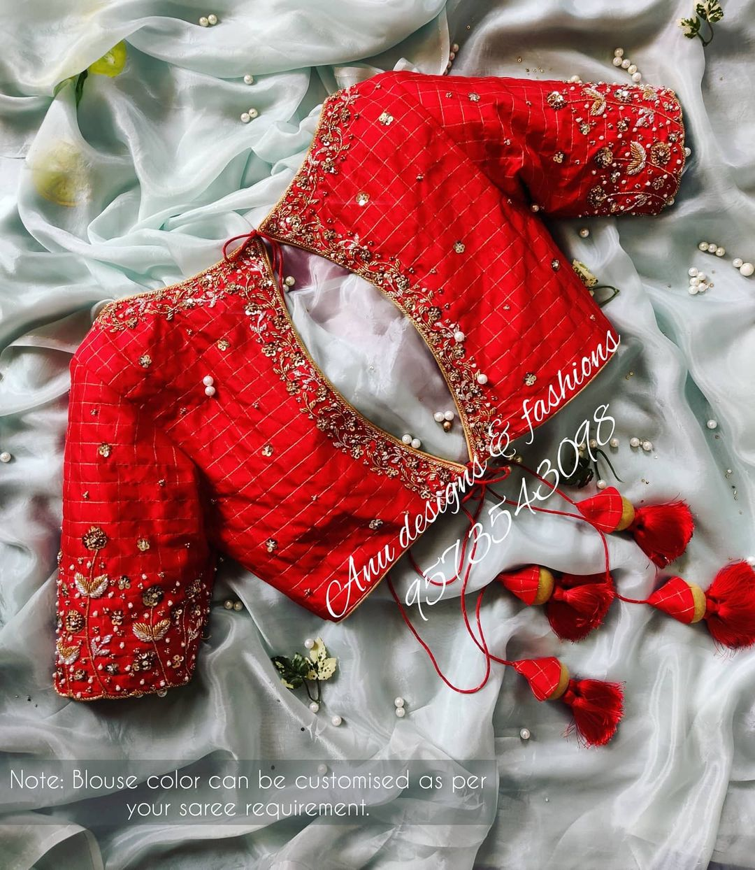 Gorgeous red designer blouse with key hole . Blouse with hand embroidery 3D maggam work.  2021-04-07