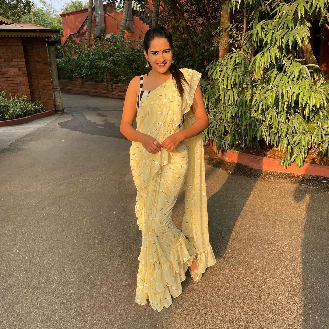 Beautiful actress Himaja in lime yellow color ruffle saree.  Saree by swa sa designer studio. 2021-04-07