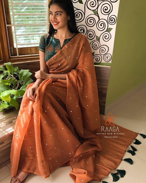 SILVER SPARKLES !  Soft chanderi saree in earthy brown highlighted with all over mirrors  absolutely light in weight  body hugging and comfortable as you drape and move . Bottle green hand block printed blouse in mangalagiri cotton adds up the to the classy look.  . . Saree Price Only - 3400 INR  Blouse material (unstitched) - 700 INR  Blouse stitching  fall and pico are done at additional price .  . . Kindly WhatsApp  at 7995036666 for placing orders . 2021-04-08