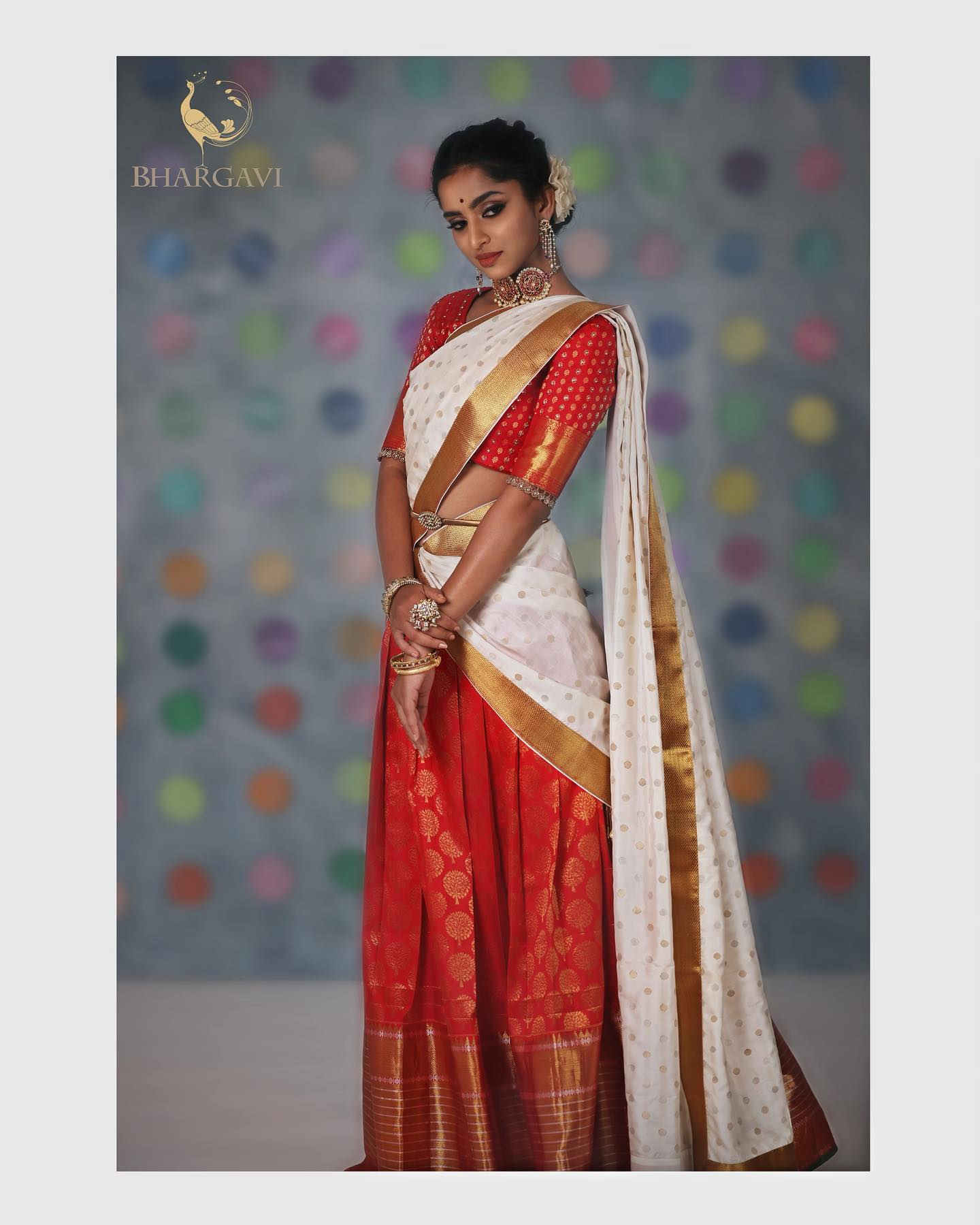 traditional kanchi pattu halfsaree.... The portrait of a traditional Indian woman is often an extremely enticing image of a beautiful maiden draped in a half saree with long braided hair going about her ways of life. This very image often portrayed right from Bapu's days is what has inspired Bhargavi to come up with this collection dedicated to the Sisterhood of today's contemporary women who are looking to connect with their roots again!  2021-04-08