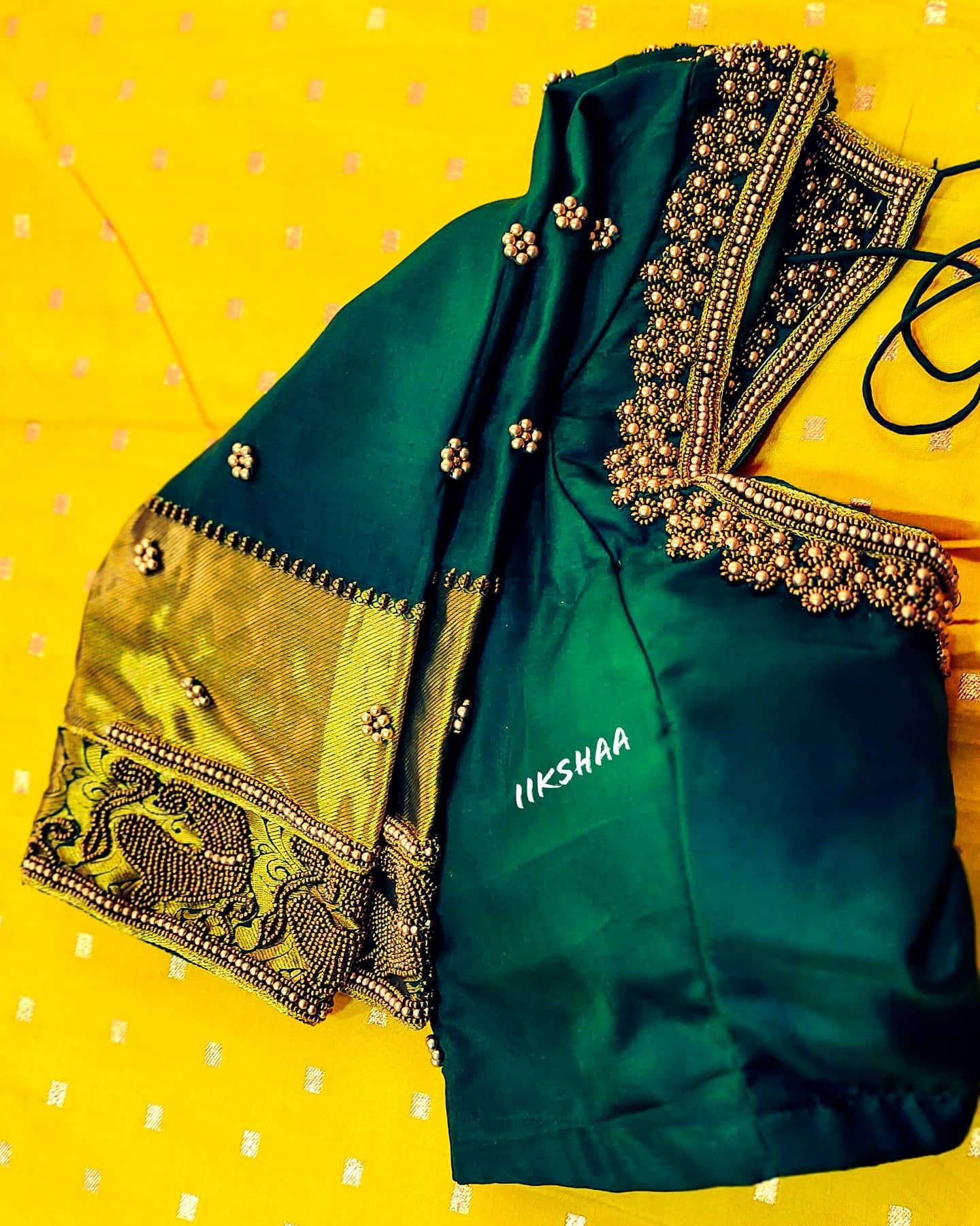 Gorgeous bottle green color  designer blouse with floral buti design hand embroidery bead aari work on neckline and sleeves.  2021-04-08