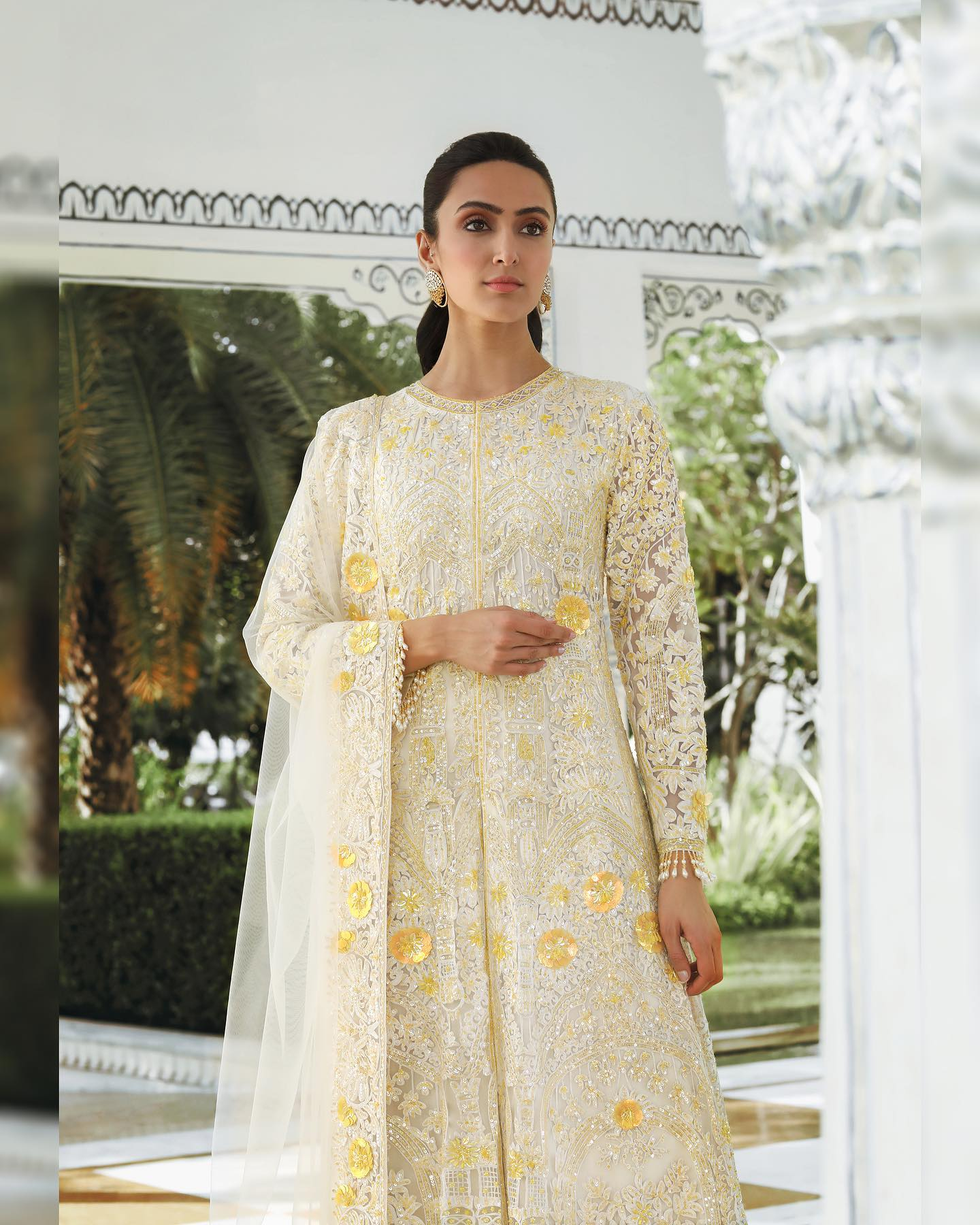She chased the sun till it shone brightly in Manish Malhotra Kashmiri embroidered ensemble highlighted with sprinkles of holographic yellow sequins and beads accompanied by scalloped palazzo's! 2021-04-08