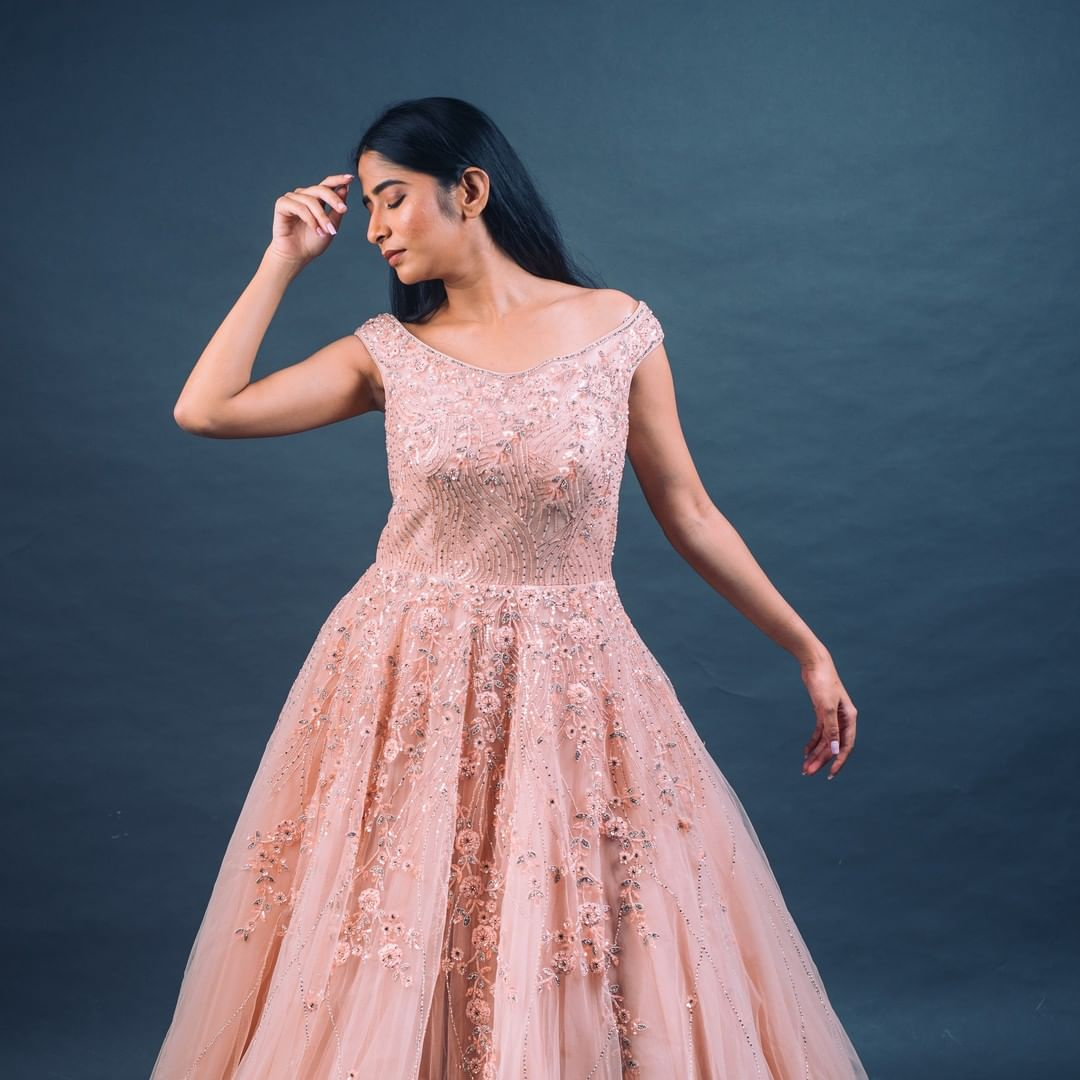 Stunning peach floor length dress with rich classy hand embroidery work. 
