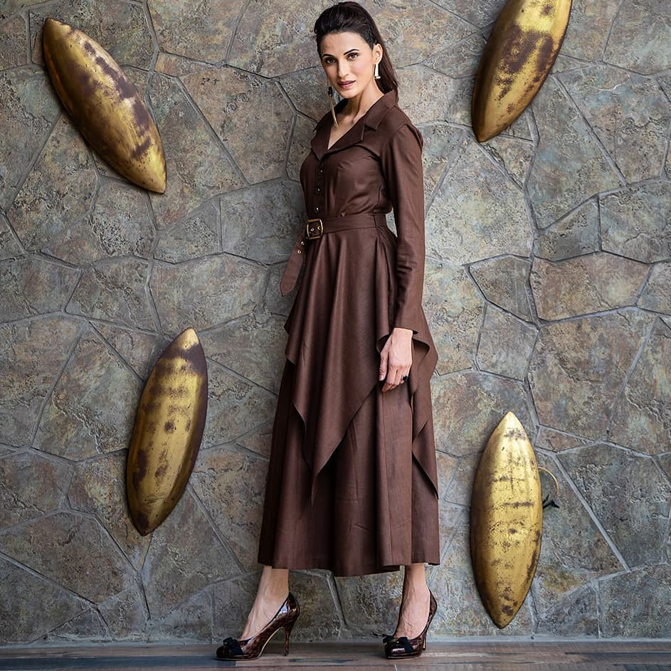 Beautiful designer Shilpa Reddy looking elegant and powerful in a studio signature structured silhouette with button-down detailing. The flowing asymmetrical drape and the chocolate brown colors bring in a classic yet a modern look. Made out of natural cotton fabric. DM or call  for any product-related queries. You can also mail  at info@shilpareddystudio.com. 2021-04-08
