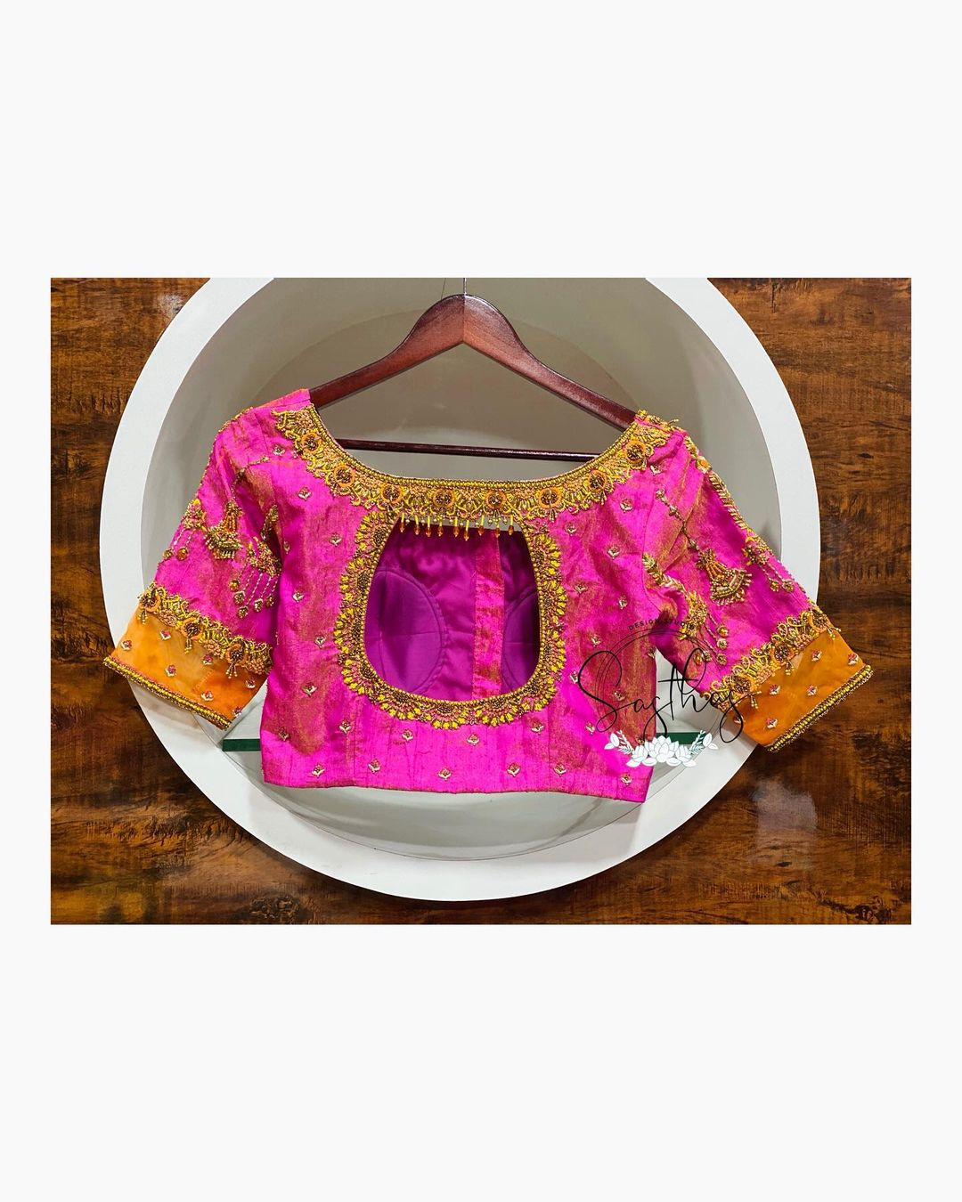 Gorgeous pink color designer blouse with floral and maang tikka design hand embroidery gold thread aari work.  2021-04-08
