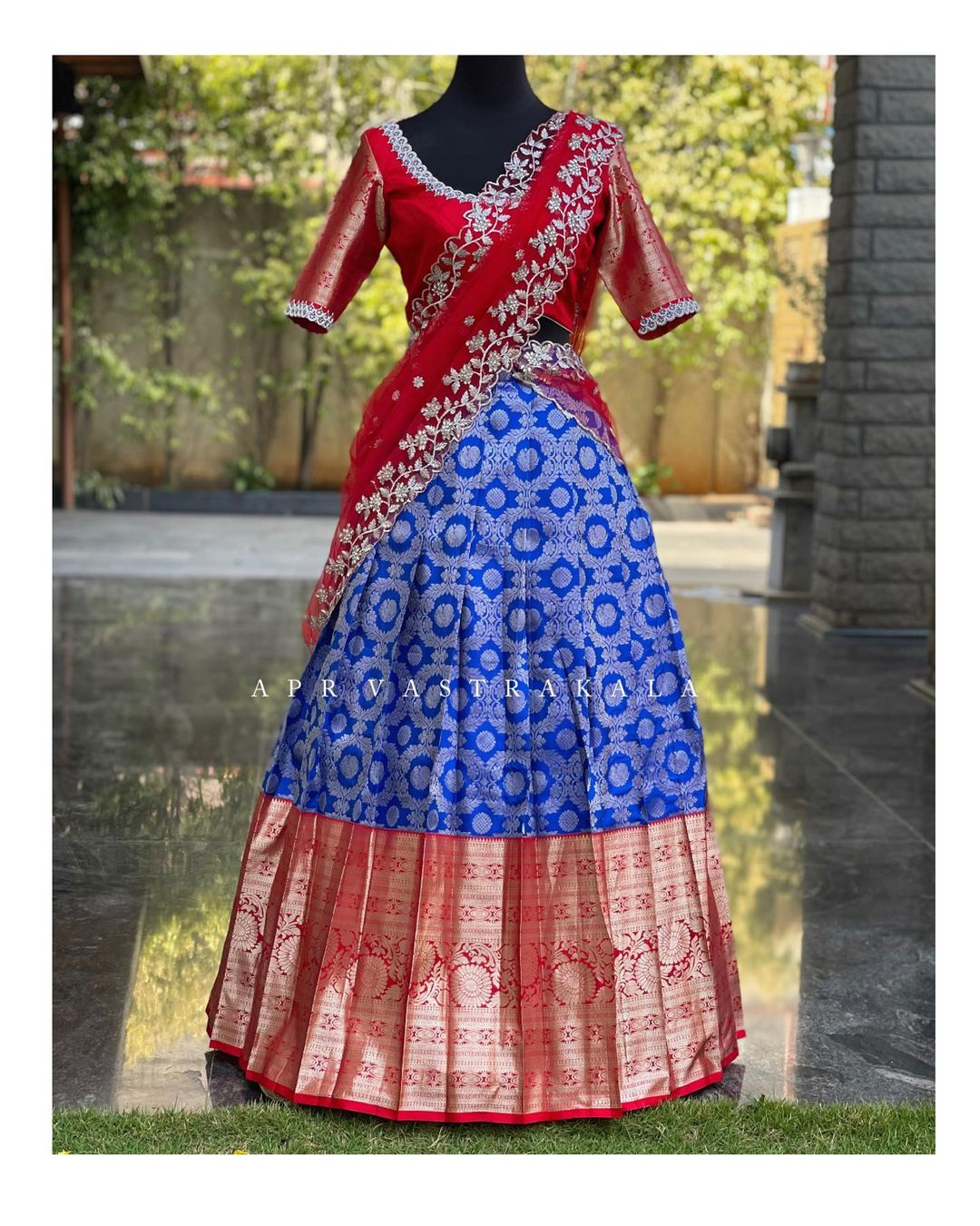 Stunning blue color kanchi pattu lehenga and red blouse with net dupatta. Dupatta with cut work.  2021-04-08