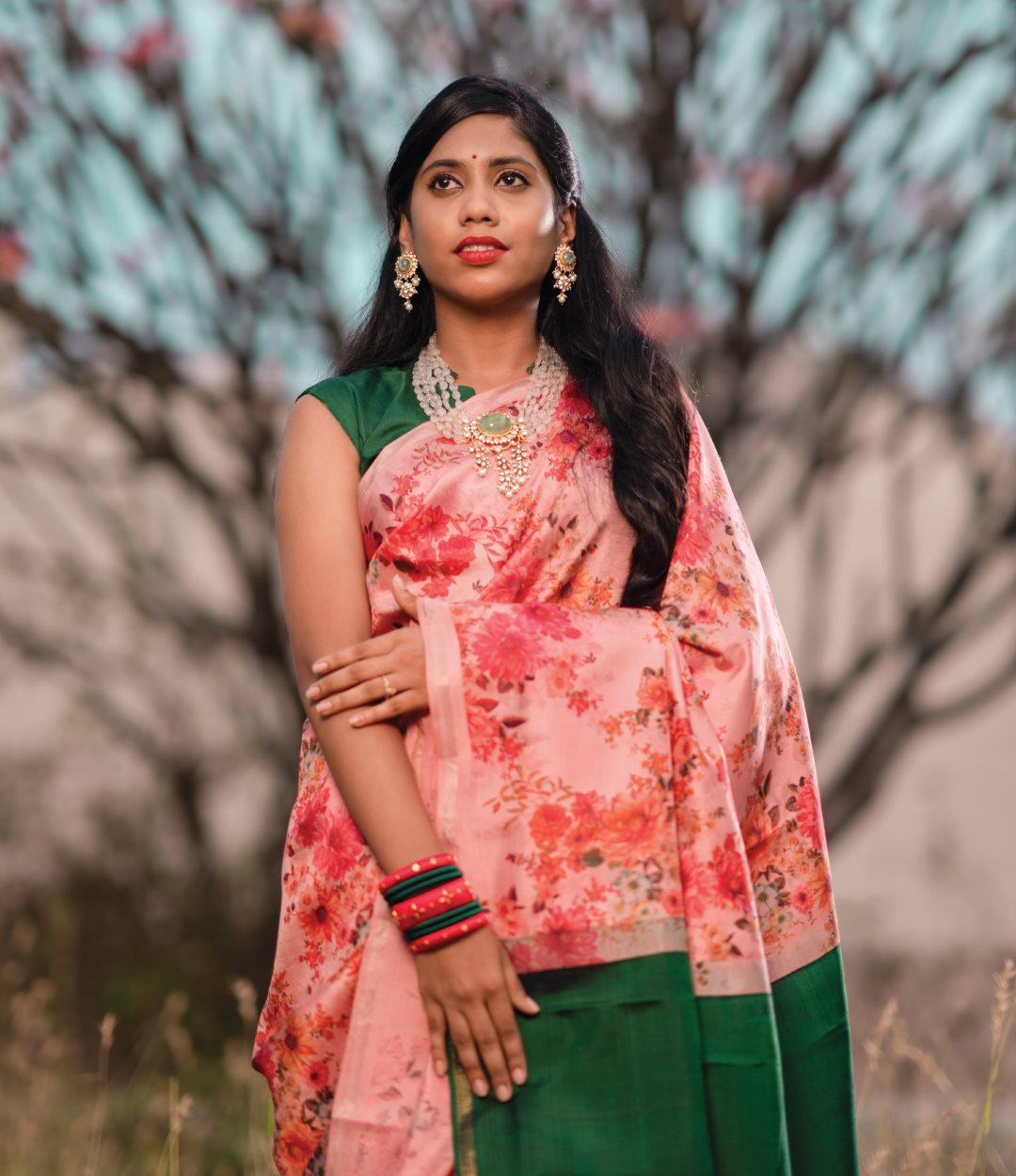 A gorgeous pastel pink floral printed Kanchi silk saree with emerald green pallu. Printed elegance - Our collection of gorgeous printed Kanchi silk sarees! 2021-04-09