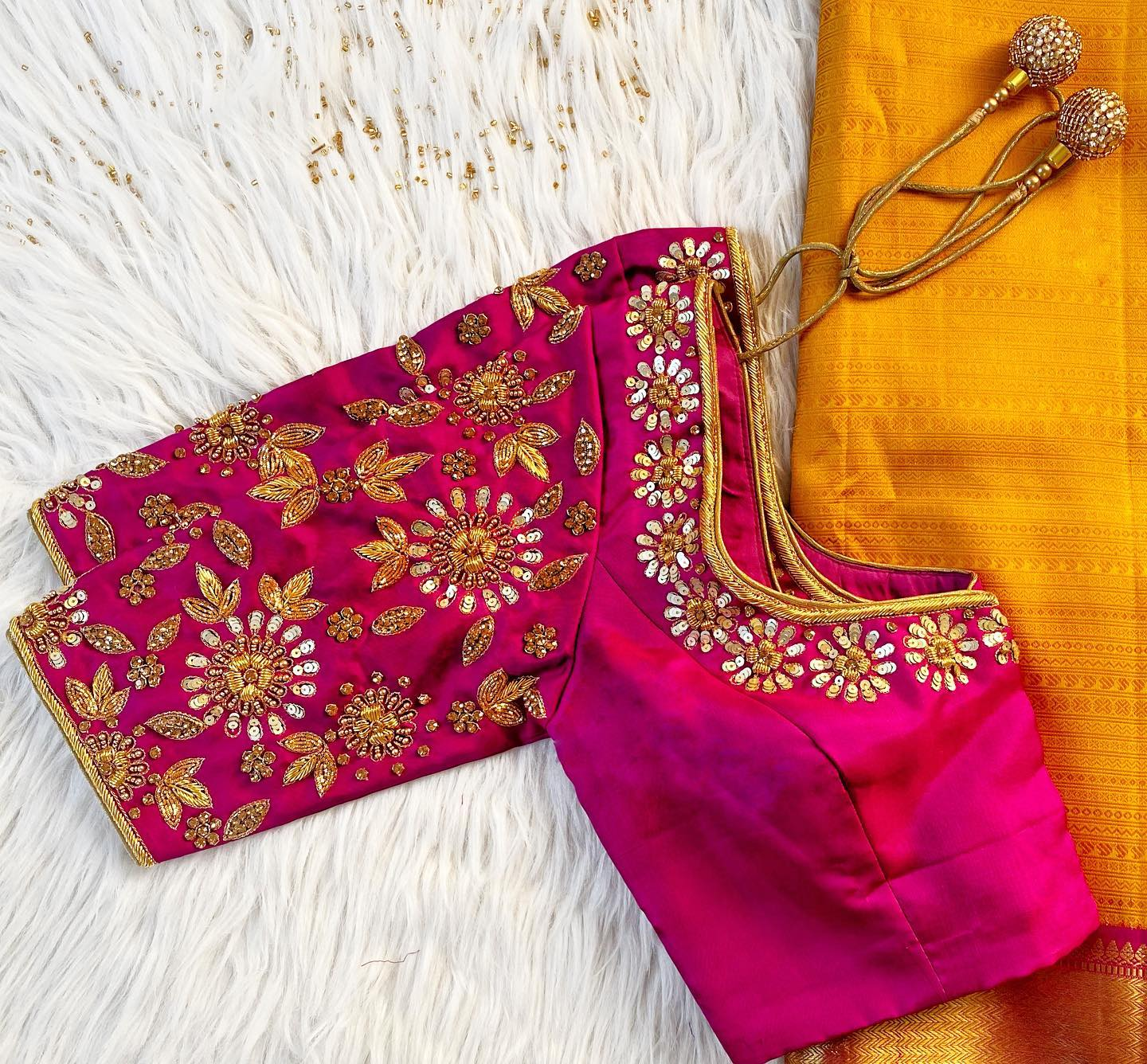 Gorgeous pink color designer blouse with floral and leaf design hand embroidery zardosi work.  2021-04-09