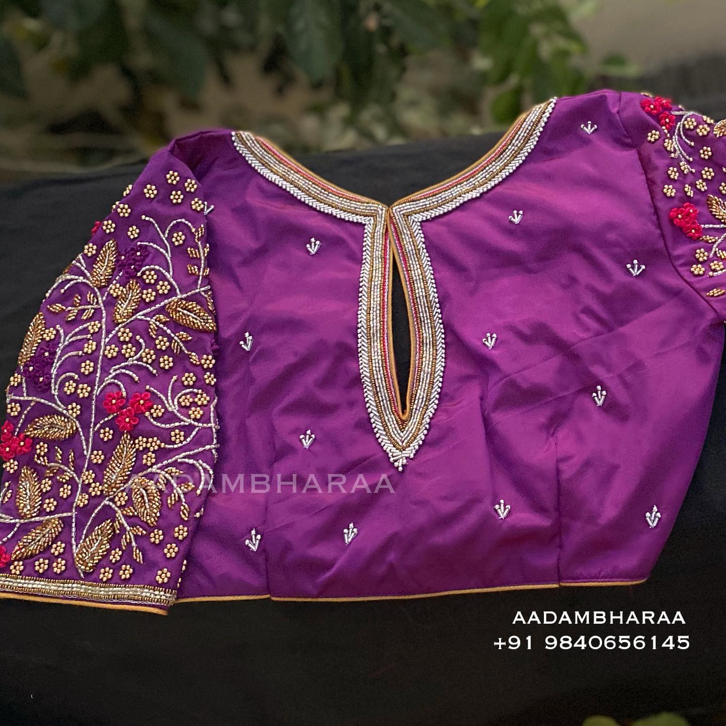 Celebrate the big moments of your life wearing Aadambharaa's unique purple blouse that is the right amount of Sparkle you need to dazzle on your special day. Gorgeous purple color designer blouse with floral buti design hand embroidery bead aari work and key hole.  2021-04-09