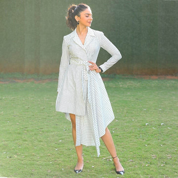 The beautiful Rakul preet Singh nailing the style game with  asymmetrical contemporary dress tunic in 100% cotton. This design is intended to create an illusion for the perfect balance of stripes and checks with a classic well-fit silhouette.