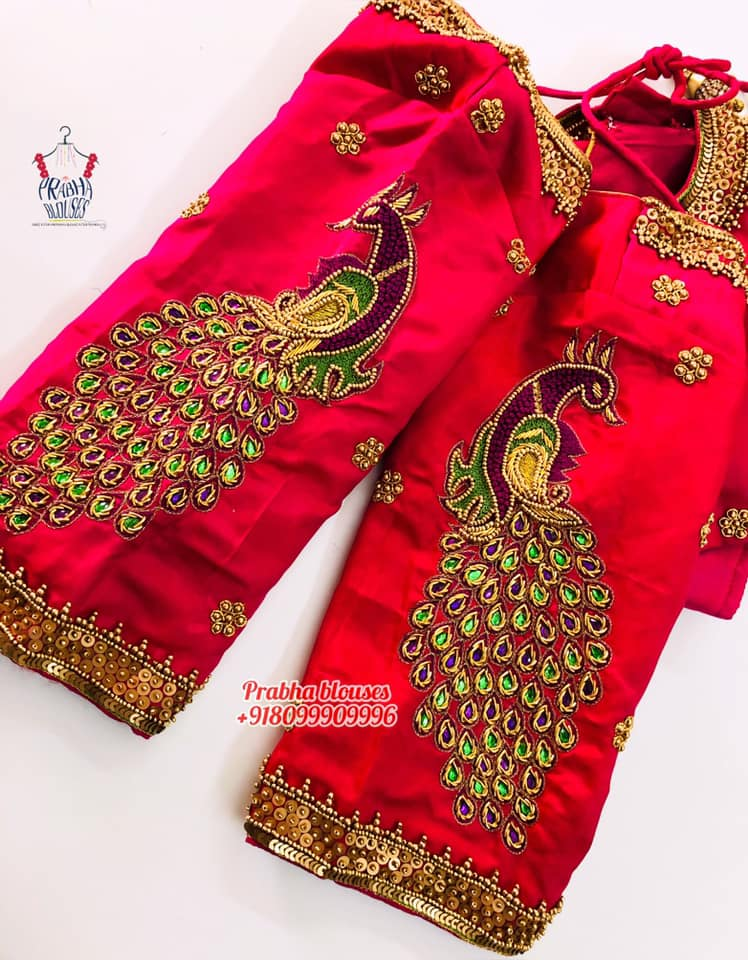 Gorgeous red color designer blouse with peacock design hand embroidery maggam work.  2021-04-10
