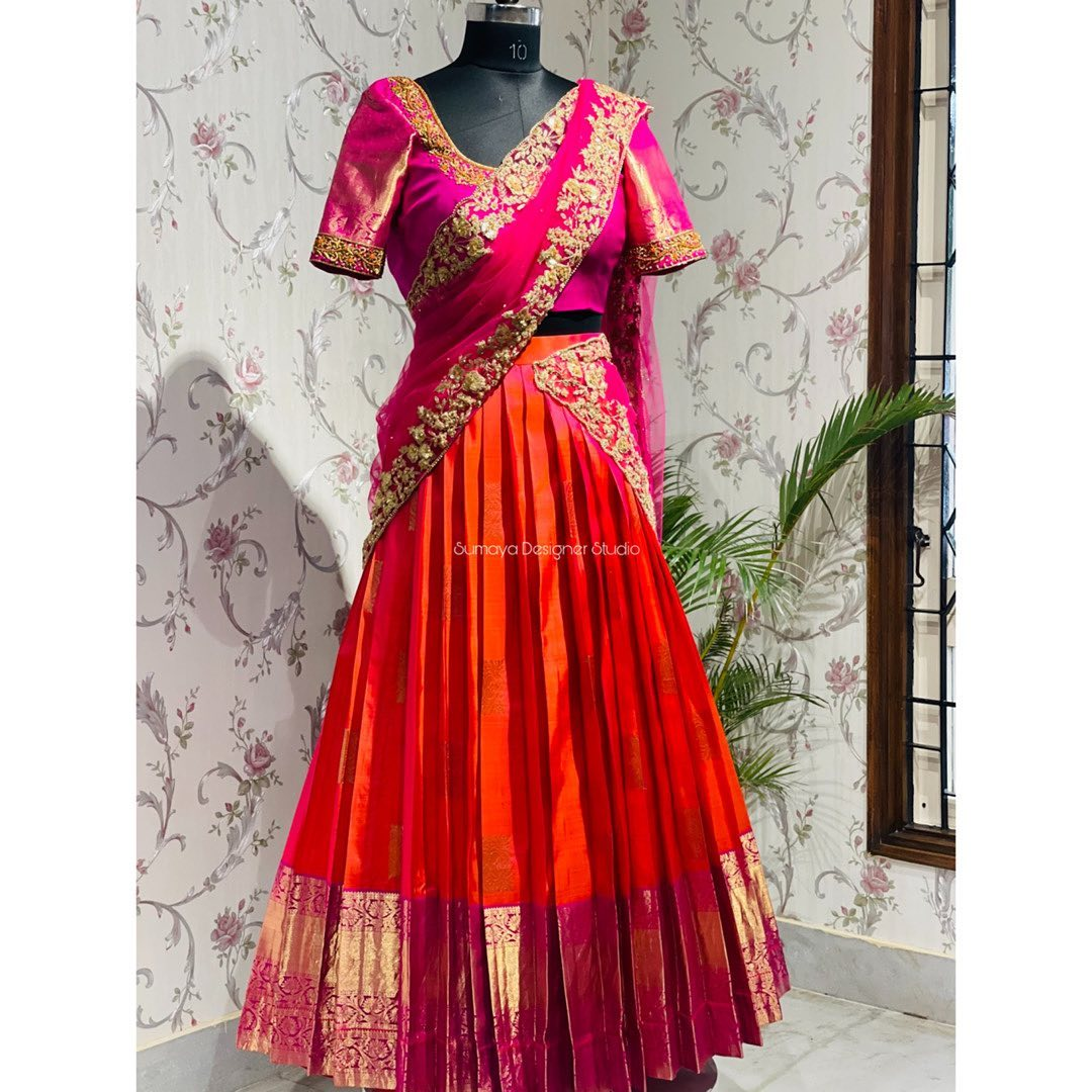 Gorgeous orange and pink color combination traditional pattu lehenga and pink blouse with embroidery net dupatta.    2021-04-10