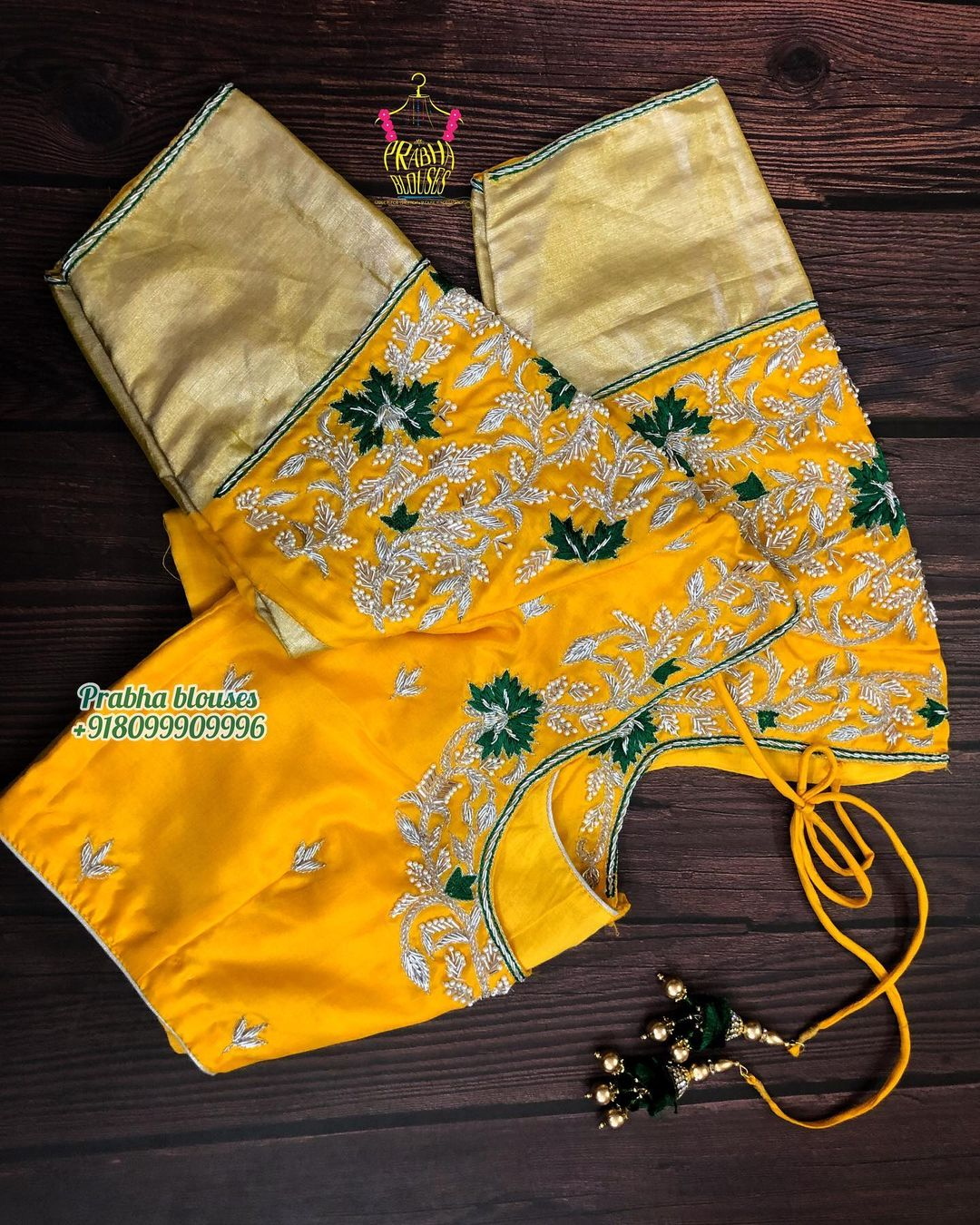 Stunning yellow color designer blouse with floral design hand embroidery gold  and green thread maggam work.  2021-04-10