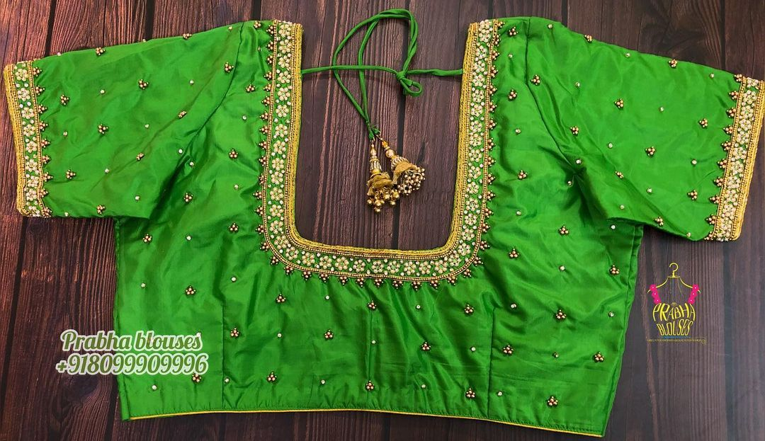 Beautiful green color designer blouse  with floral buti design hand embroidery maggam work.  2021-04-10