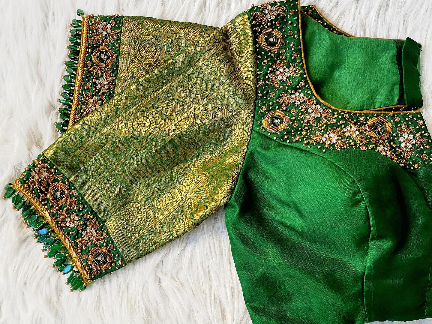 Wedding or reception green embroidered sunset bespoke blouse is perfect for any occasion. Whatsapp to 7092586311 to place your orders.  2021-04-11