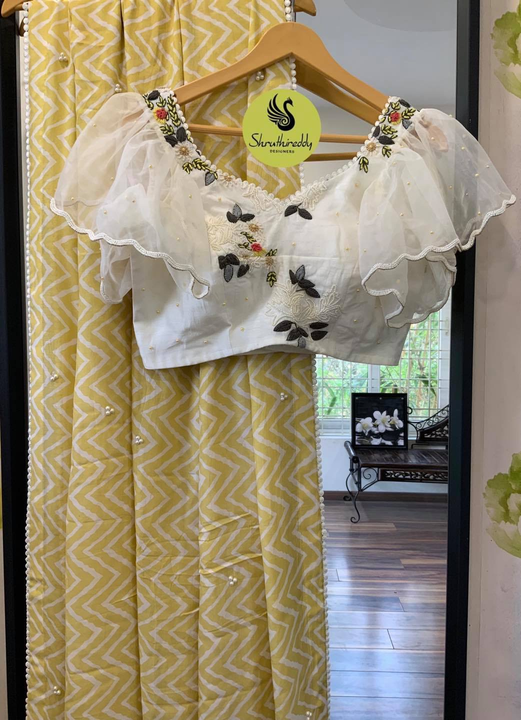 Gorgeous lime yellow color designer saree and pearl white color blouse. Blouse with ruffle sleeves and hand embroidery work.  2021-04-11