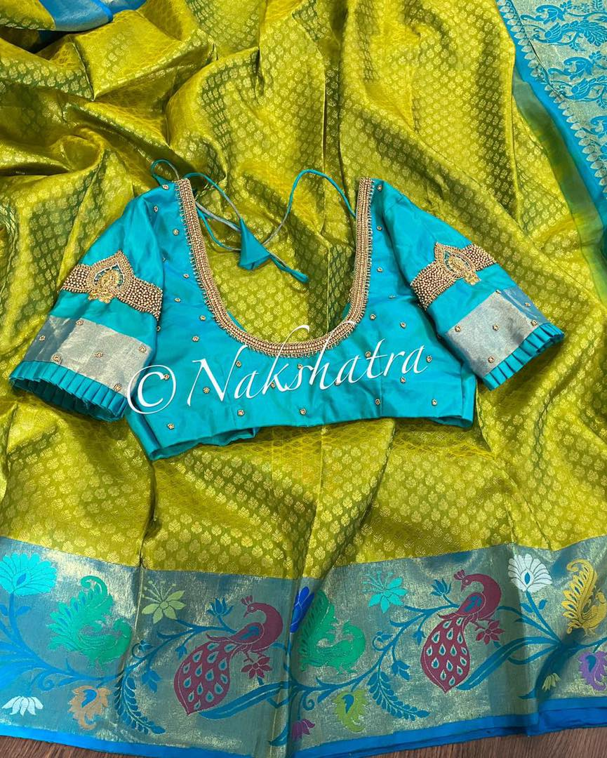 Beautiful lime green and blue combo Kanchivaram saree paired with handwork blouse. 2021-04-11
