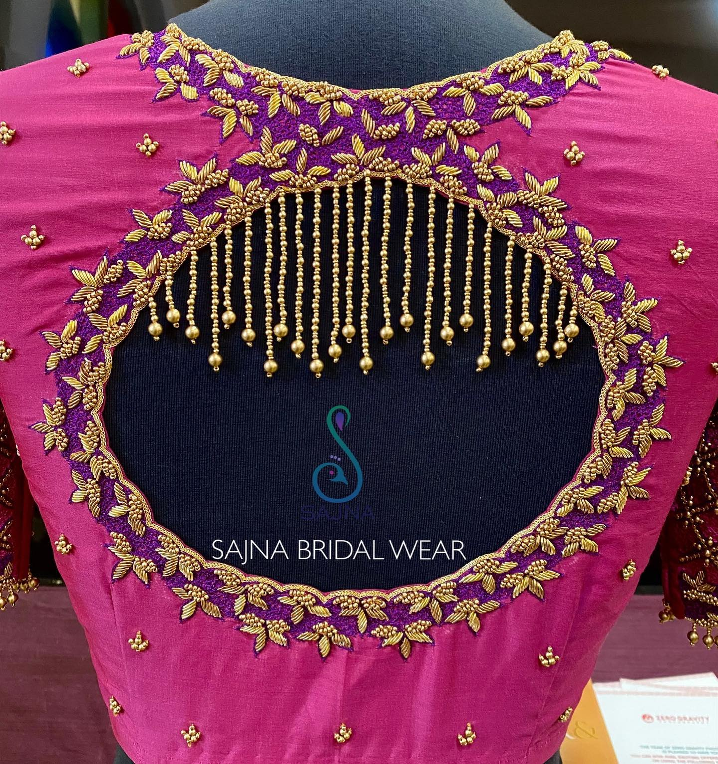 Gorgeous pink and purple combination designer blouse back with bead and gold thread aari work. 2021-04-11