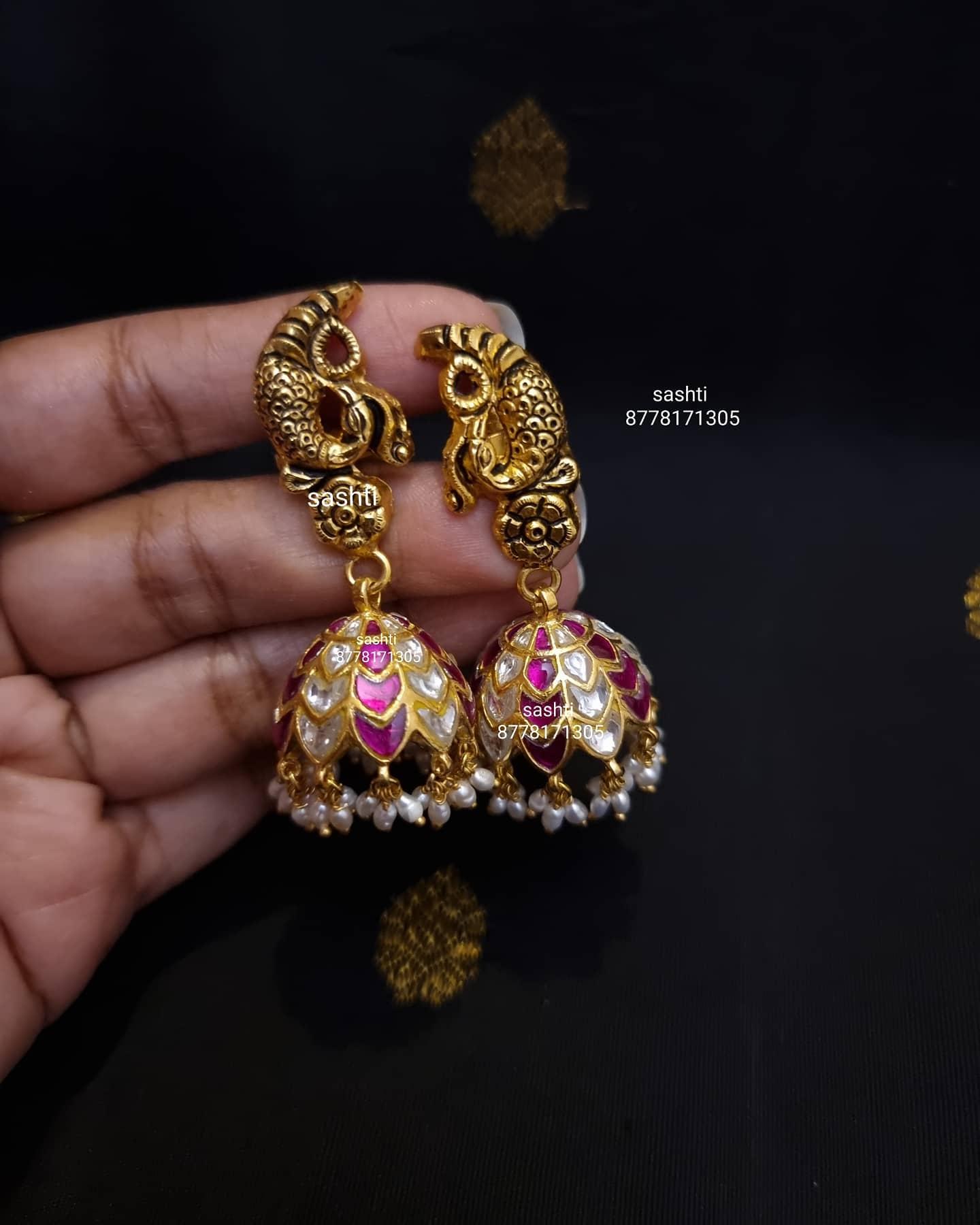 Beautiful silver jumkhis with gold polish. Jumkhis studded with stones. 2021-04-11