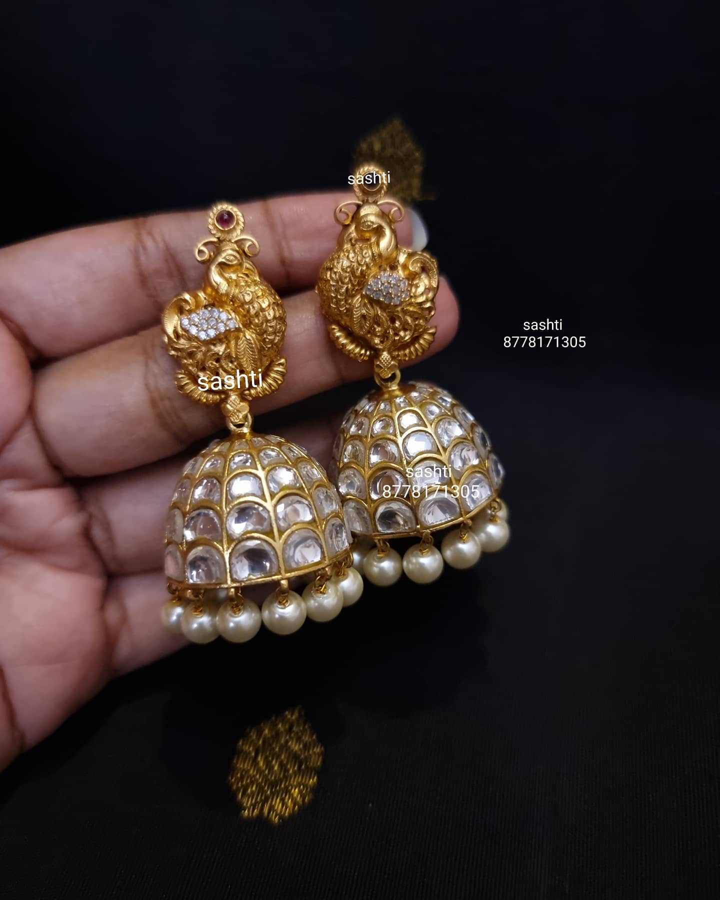 Beautiful silver jumkhis with gold polish. Jumkhis studded with stones. 2021-04-11
