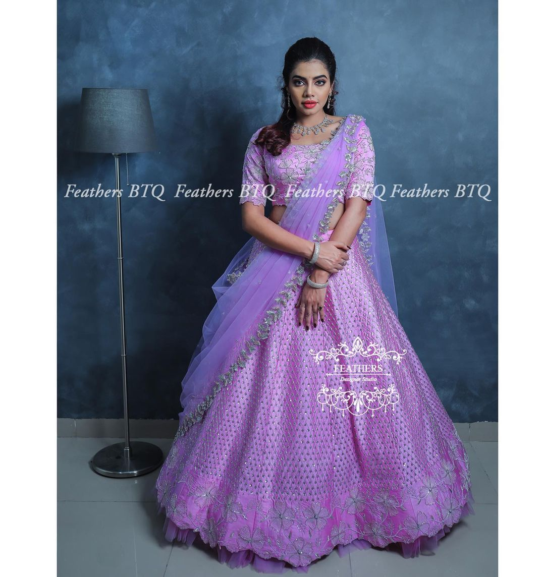 """Beautiful lavender umbrella cut lehenga and blouse with net dupatta. """"Fall in Love"""" featured pastel and ivory hues multiple layers of fine embellishments and a soft romantic aesthetic. Blush pinks turmeric yellows and aquamarines .... 2021-04-11"""