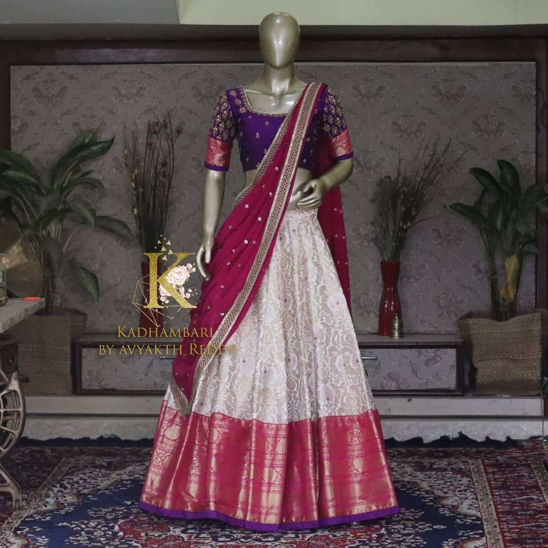 Gorgeous Kanchi pattu lehenga and blue color blouse with wine net dupatta. Blouse with hand embroidery work.  This outfit is Available at Rs 13800/- from house of Kadhambari. They can customize size as per your requirement. They have international shipping service too. For Orders and Enquiry Reach  on WhatsApp +91 8801876477 // +91 9063479099 2021-04-11
