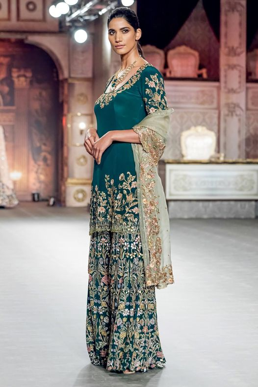 An emerald panelled Sharara with intricate resham and golden embroidery. 2021-04-12