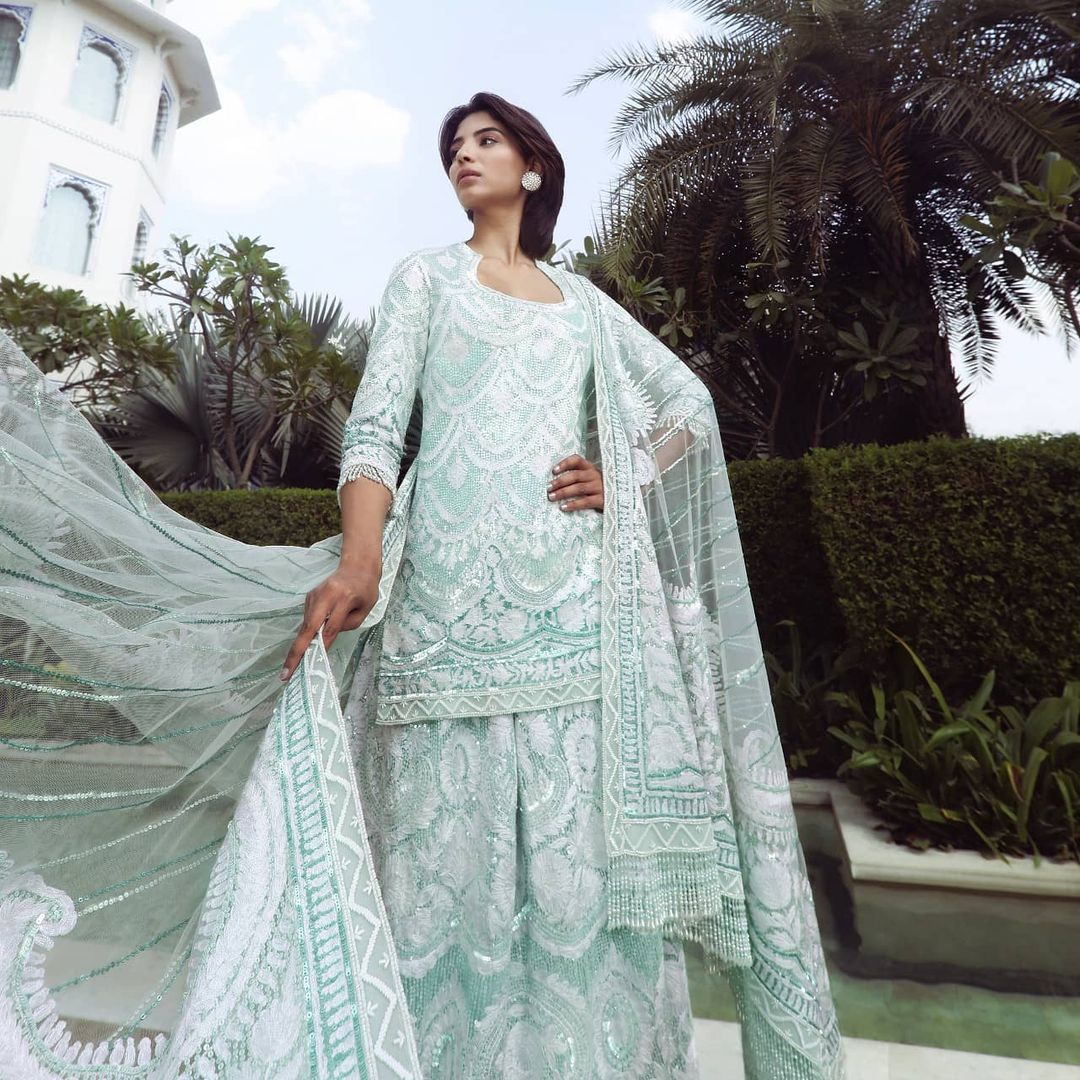 Adding an extra dose of oceanic oasis to your timeless wardrobe with Mansih Malhotra artisanal aquamarine Sharara Kurti set intertwined in Kashmiri embroidery and our signature sequins work! 2021-04-12